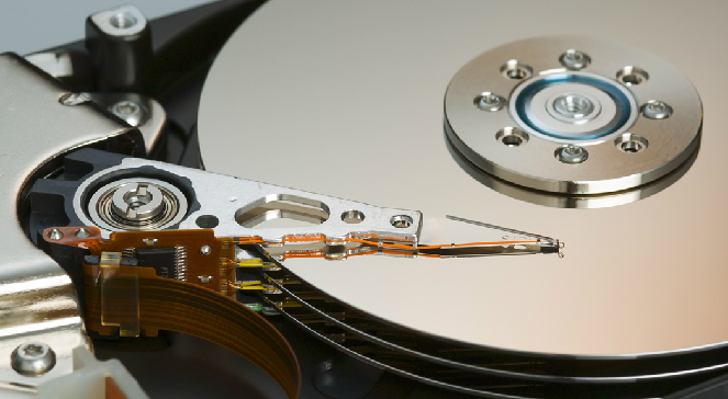 Механизм привода головок жесткого диска